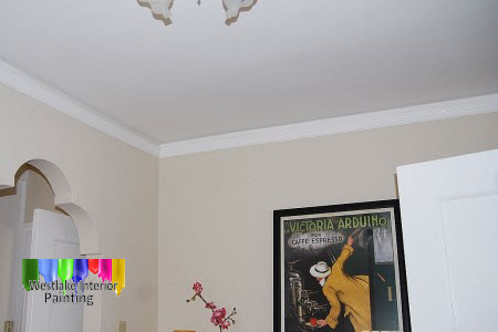 The walls in the living room were very damaged. After doing some prep work to the walls, ceiling and trim we applied new ceiling paint to the ceiling and a semi gloss finish to all the trim. Next we gave the walls a neutral color flat finish  making the room look like brand new.