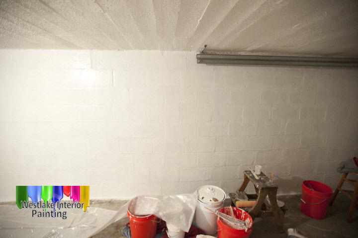 After the walls were primed we applied two coats of ceiling paint to the ceiling, two coats of a semi gloss finish to the walls, and on the garage floor we used an Exterior latex acrylic paint.